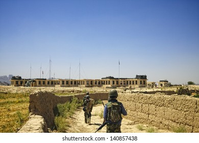 KANDAHAR, AFGHANISTAN - JUNE 30: A joint patrol between International Security Assistance Force soldiers and Afghan Soldiers returns to their base on June 30, 2010 in Kandahar Province, Afghanistan.