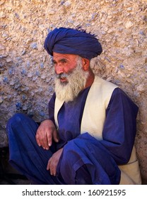 KANDAHAR, AFGHANISTAN - MAY 2010: An Afghan village elder sits and talks to ISAF forces in Kandahar Province, Afghanistan.