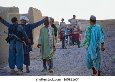 KANDAHAR, AFGHANISTAN - MAY 2010: Afghan policemen conduct routine searches in a village in Kandahar Province, Afghanistan.