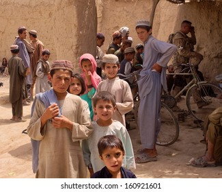 KANDAHAR, AFGHANISTAN - MAY 2010:  A crowd of children gather in a village market in Kandahar Province, Afghanistan.