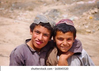 KANDAHAR, AFGHANISTAN - MAY 22, 2010:  Two friends pose for the camera during a patrol in a village in Kandahar Province, Afghanistan.