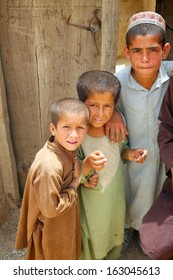 KANDAHAR, AFGHANISTAN - MAY 22, 2010: Friends pose for the camera during a patrol in a village in Kandahar Province, Afghanistan.