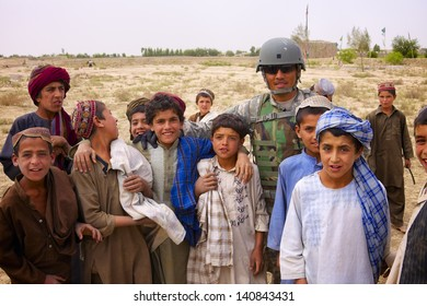 KANDAHAR, AFGHANISTAN - MAY 8: Children gather around ISAF forces at the site of a village work project on May 8, 2010 in Kandahar Province Afghanistan.