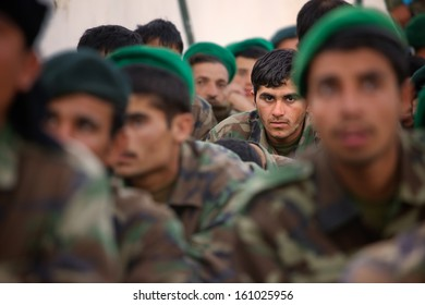KANDAHAR, AFGHANISTAN - SEPTEMBER 2010: An Afghan National Army soldier looks listens during a training event hosted by ISAF Forces.