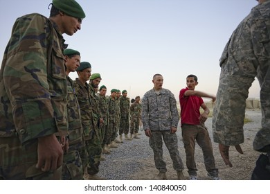 KANDAHAR, AFGHANISTAN - SEPTEMBER 24: Afghan Soldiers listen carefully to training provided by ISAF Forces on September 24, 2010 in Kandahar Province Afghanistan.