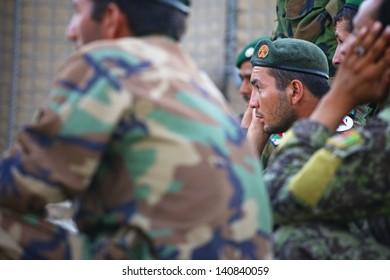 KANDAHAR, AFGHANISTAN - SEPTEMBER 24: An Afghan Soldier listens carefully to training provided by ISAF Forces on September 24, 2010 in Kandahar Province Afghanistan.