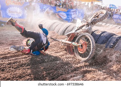 KANDAL PROVINCE, CAMBODIA - Nov 1, 2015: A racer fall down as he could not make it after the truck's tire obstacle.