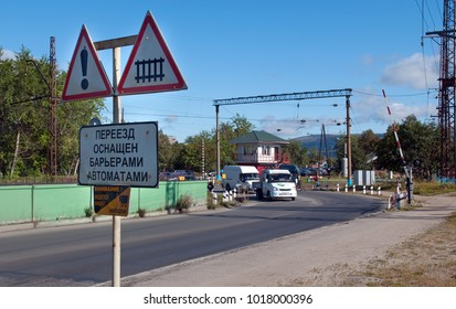 Kandalaksha, Russia - August 28, 2012: Road to the railway crossing
