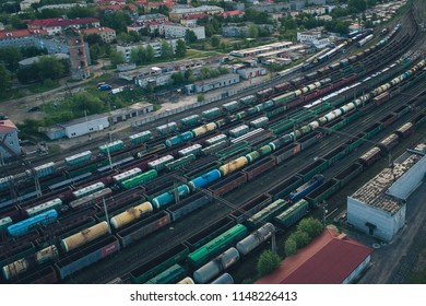 KANDALAKSHA, RUSSIA - JUNE 10, 2018: Railway Station with lots of Lines and Freight Trains. Aerial View. Location Kandalaksha Russia