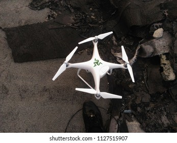 KANDALAKSHA, RUSSIA - MAY 24, 2018: DJI Phantom 4 Pro Drone Found on the Roof of the Building after Losing Control in a Strong Wind and Automatic Landing at a Critical Discharge of the Battery