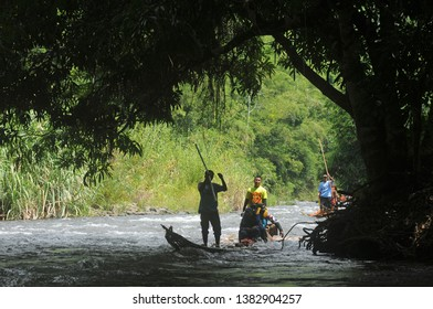 Kandangan, South Kalimantan, Indonesia, 25 - November - 2018: bamboo rafting or white water rafting is a typical Kalimantan sport, navigating rapids using bamboo which only exists in South Kalimantan