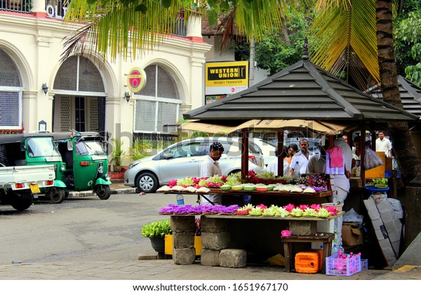 Kandy City/Sri Lanka-November 2016: A small and beautiful flower shop selling bright colorful flowers . These flowers are offered in the nearby Budha tooth relic temple