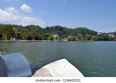 Kandy, Sri Lanka - April 5, 2018: View of Bogambara Lake, the artificial lake of Kandy with the Royal Bath building and the Diyathilaka Mandapaya island.