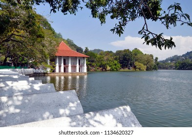 Kandy, Sri Lanka - April 5, 2018: View of Bogambara Lake, the artificial lake of Kandy and the Royal Bath building.
