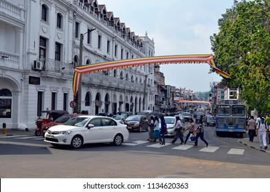 Kandy, Sri Lanka - April 5, 2018: DS Senanayake Veediya at the intersection with Sri Dalada Veediya, with Queen's Hotel on the left.