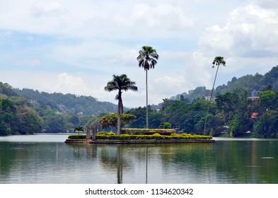 Kandy, Sri Lanka - April 6, 2018: View of Bogambara Lake, the artificial lake of Kandy and the Diyathilaka Mandapaya island.