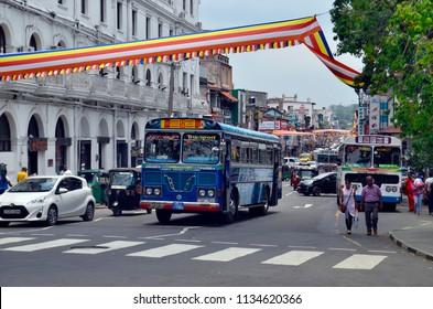 Kandy, Sri Lanka - April 6, 2018: DS Senanayake Veediya at the intersection with Sri Dalada Veediya, with Queen's Hotel on the left.