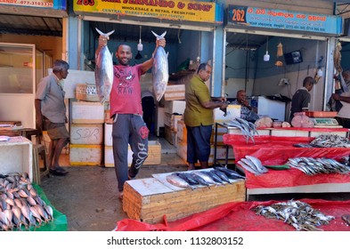 Kandy, Sri Lanka - April 7, 2018: At the bustling and colorful Kandy Municipal Central Market you can find fruit and vegetable, meat, fish, dry food, seasonings and other stuff related to food.