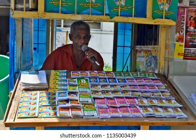 Kandy, Sri Lanka - April 7, 2018: Lottery tickets vendor in his booth promoting his business with his public address system.