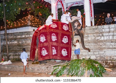 KANDY, SRI LANKA - AUG 11, 2005: people prepare the elefant for participation at the festival Pera Hera in Kandy to celebrate the tooth of Buddha in Kandy, Sri Lanka.