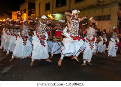 KANDY, SRI LANKA - AUGUST 02, 2017 : Up Country Dancers (Kandyan Dancers) perform along a street in Kandy during the Buddhist Esala Perahera (great procession).