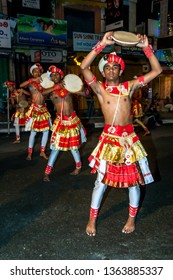 KANDY, SRI LANKA - AUGUST 02, 2017 : Dancers parade along a street in Kandy during the Buddhist Esala Perahera (great procession).
