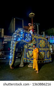 KANDY, SRI LANKA - AUGUST 02, 2017 : A ceremonial elephant parades along a street in Kandy during the Buddhist Esala Perahera (great procession).