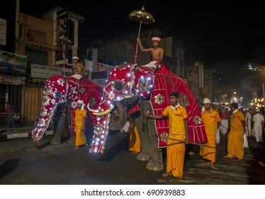 KANDY, SRI LANKA - AUGUST 02, 2017 : Ceremonial elephants parade down a street in Kandy during the Esala Perahera (great procession). The perahera is held to honour the Sacred Tooth Relic of Buddha.