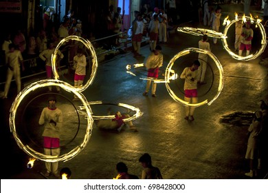 KANDY, SRI LANKA - AUGUST 03, 2014 : A spectacular site as Fire Ball Dancers perform along Colombo Street during the Esala Perahera or great procession held to honour the sacred tooth relic of Buddha.