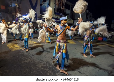KANDY, SRI LANKA - AUGUST 04, 2017 : Chamara Dancers perform along the streets of Kandy in Sri Lanka during the Esala Perahera (great procession) which honours the sacred tooth relic of Buddha.