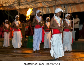 KANDY, SRI LANKA - AUGUST 05, 2014 : Sword Carriers perform along the streets of Kandy in Sri Lanka during the Esala Perahera (great procession). The perahera is a Buddhist festival.