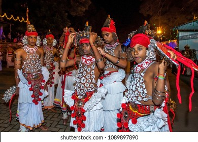 KANDY, SRI LANKA - AUGUST 07, 2014 : Up Country Dancers prepare their costumes prior to the Esala Perahera (great procession) which is a Buddhist festival held at Kandy in Sri Lanka.