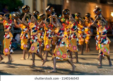 KANDY, SRI LANKA -  AUGUST 09, 2014 : Procession of the Paththini Devala dancers perform carrying pots above their head to honour the Goddess Paththini during the Esala Perahera (great procession).