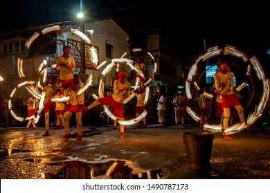 KANDY, SRI LANKA - AUGUST 10, 2019 : Fire Ball Dancers perform along the streets of Kandy during the Buddhist Esala Perahera (great procession). They light the route of the perahera with fire.