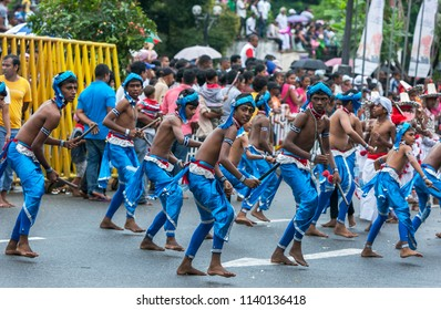 KANDY, SRI LANKA - AUGUST 11, 2014 : Wood Tappers perform along the streets of Kandy during the Day Perahera which takes place on the final day of the Buddhist Esala Perahera.
