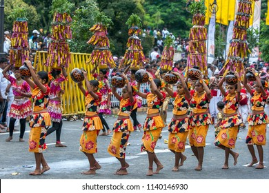 KANDY, SRI LANKA -  AUGUST 11, 2014 : Procession of the Paththini Devala dancers perform carrying pots above their head to honour the Goddess Paththini during the Day Perahera (great procession).