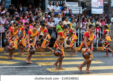 KANDY, SRI LANKA -  AUGUST 11, 2014 : Procession of the Paththini Devala dancers perform carrying pots  to honour the Goddess Paththini during the Day Perahera (great procession).