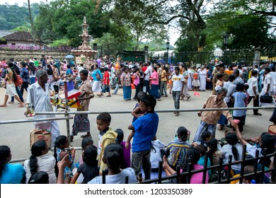 KANDY, SRI LANKA - AUGUST 11, 2013 : A huge crowd of people congregate on a street in Kandy prior to the commencement of the Buddhist Esala Perahera (great procession).