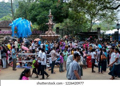KANDY, SRI LANKA - AUGUST 11, 2013 : A crowd of hundreds of people gather outside the Temple of the Sacred Tooth Relic prior to the start of the Esala Perahera (great Procession).