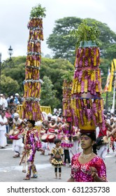 KANDY, SRI LANKA - AUGUST 11, 2014 : Dancers wearing brilliant costumes with amazing headwear perform to the beat of drummers along the streets of Kandy during the Day Perahera (Esala Perahera).