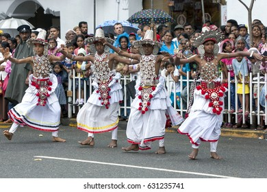 KANDY, SRI LANKA - AUGUST 11, 2014 : Up Country Dancers perform on the streets of Kandy during the Day Perahera on the final day of the Esala Perahera held to honour the sacred tooth relic of Buddha.