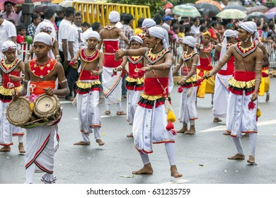 KANDY, SRI LANKA - AUGUST 11, 2014 : Young musicians including Cymbal Players and Thammattam Players perform along the streets of Kandy during the Day Perahera which is the last day of Esala Perahera.
