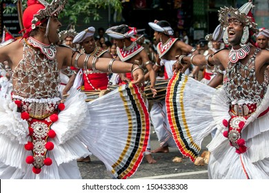 KANDY, SRI LANKA - AUGUST 15, 2019 : Kandyan Dancers, otherwise known as Up Country Dancers, perform along a street during the Buddhist Day Perahera at Kandy in Sri Lanka.