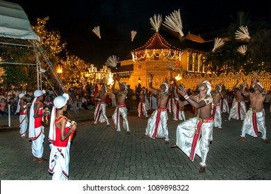 KANDY, SRI LANKA - AUGUST 16, 2013 : Coconut Flower Dancers perform infront of the Temple of the Sacred Tooth Relic during the Esala Perahera (great procession). The perahera is a buddhist festival.