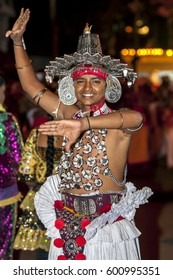 KANDY, SRI LANKA - AUGUST 20, 2013 : A Ves Dancer (Up Country dancer) performs during the Esala Perahera. The Esala Perahera is held to honour the Sacred Tooth Relic of Lord Buddha.