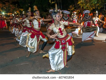 KANDY, SRI LANKA - AUGUST 20, 2013 :  Female dancers perform in the Esala Perahara (great procession) in Kandy. The perahera is held to honour the Sacred Tooth Relic of Buddha.