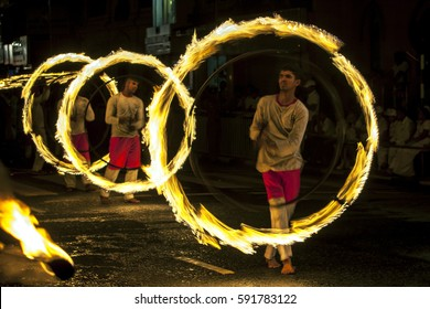 KANDY, SRI LANKA - AUGUST 25, 2015 : Fire Ball Dancers perform along the streets of Kandy during the Esala Perahera (great procession). This is a Buddhist festival.