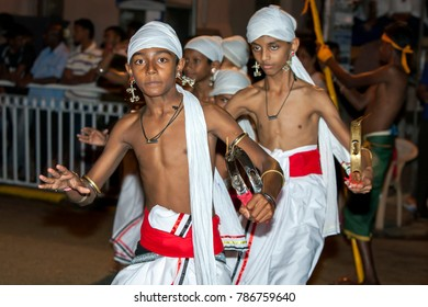 KANDY, SRI LANKA - AUGUST 25, 2015 : Tamerine Players perform along a street during the Esala Perahera. The Esala Perahera (great procession) is held to honour the sacred tooth relic of Lord Buddha.