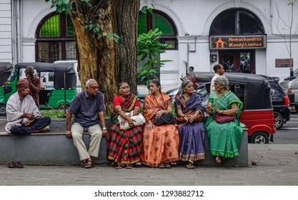 Kandy, Sri Lanka - Dec 15, 2018. Local women sitting on street in Kandy, Sri Lanka. Sri Lanka has among the lowest extreme poverty rates among countries in Asia.