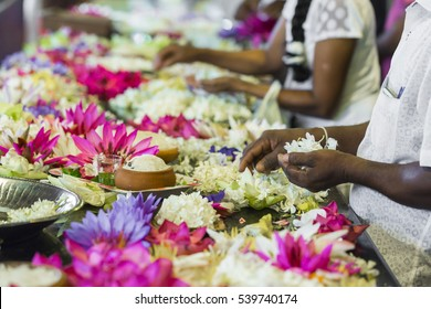 KANDY, SRI LANKA - DECEMBER 01, 2016: Temple Of The Sacred Tooth RelicThe inside view. People bring flowers to the Temple. Kandy, Sri Lanka